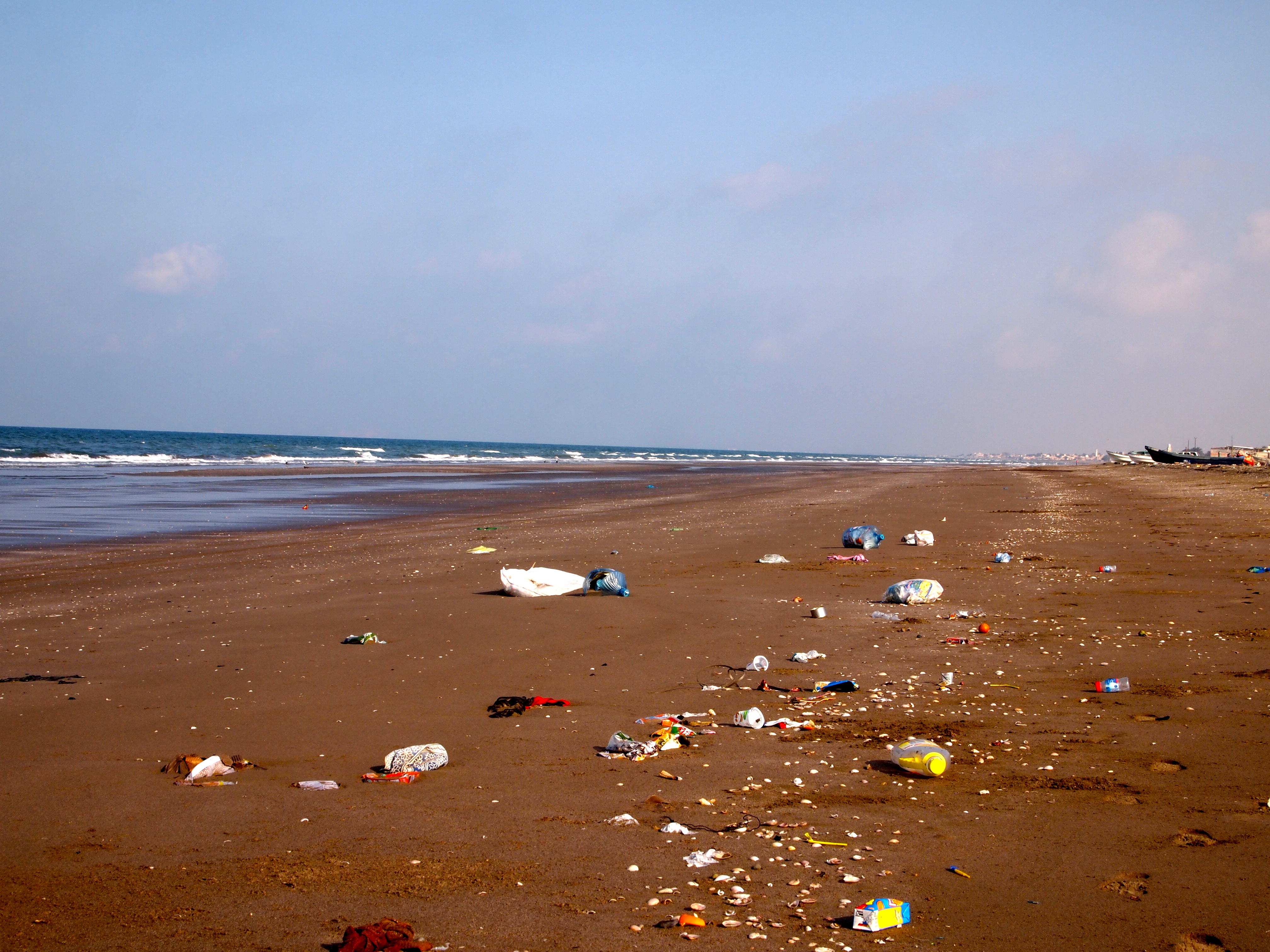 The Pollution Of Oman S Beaches Suitcase And Umbrella
